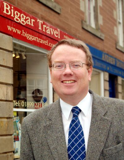 david outside biggar travel shop - copyright of lindsay addison